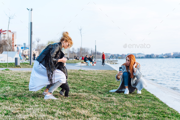 Two women and a little boy on the lake - Stock Photo - Images