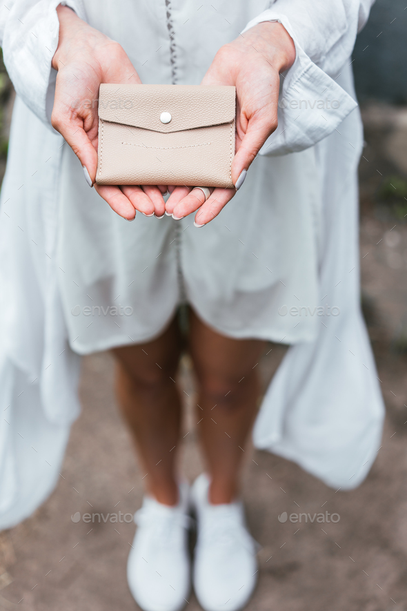Woman hands hold purse - Stock Photo - Images