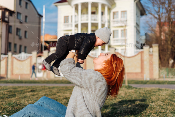 Mother and son on the grass - Stock Photo - Images