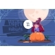 Kid Wears Witch Costume Sitting on Pumpkin