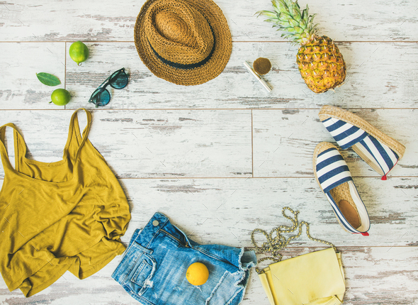 Colorful summer fashion outfit flat-lay over parquet background, copy space - Stock Photo - Images
