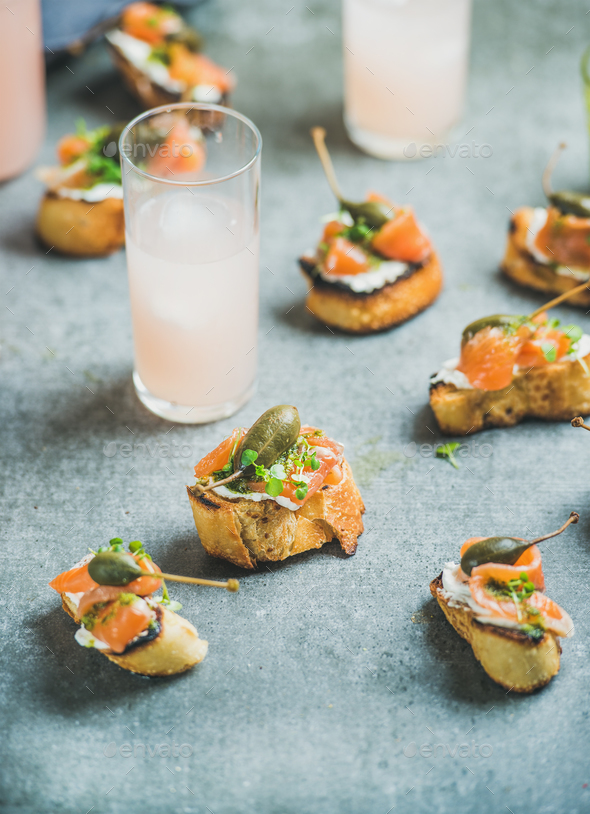 Crostini with salmon and grapefruit cocktails - Stock Photo - Images
