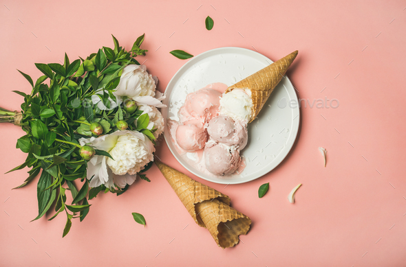Pink strawberry and coconut ice cream, cones, white peony flowers - Stock Photo - Images