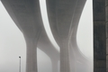 Pillars of the highway bridge in fog - PhotoDune Item for Sale
