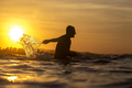 Surfer in ocean at sunset time - PhotoDune Item for Sale