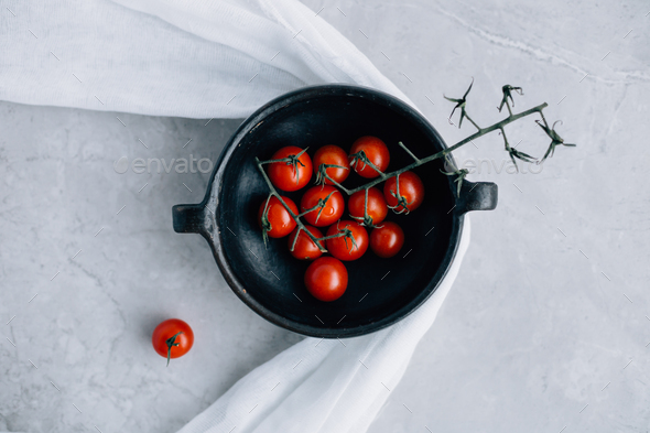 Fresh Cherry Tomatoes in Rustic Bowl - Stock Photo - Images