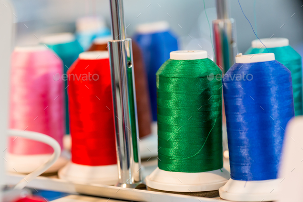 Spools of color threads closeup, sewing material - Stock Photo - Images