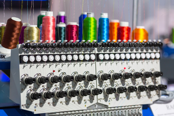 Spools of color threads closeup, spinning machine - Stock Photo - Images