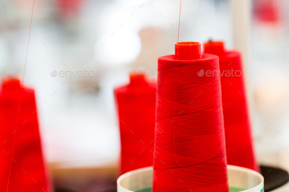 Spools of red threads closeup, sewing material - Stock Photo - Images