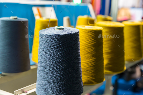 Spools of color threads closeup, sewing equipment - Stock Photo - Images