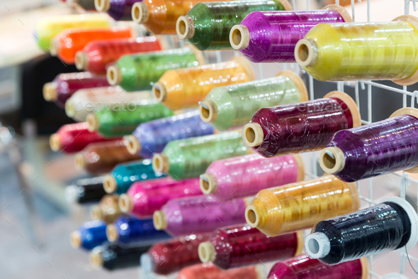 Spools of new threads closeup, sewing tools - Stock Photo - Images