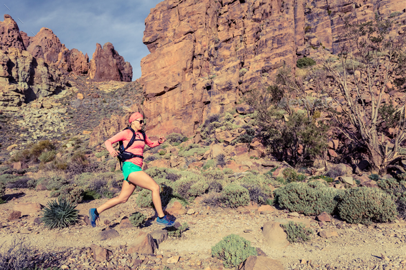 Woman trail running in mountains with backpack - Stock Photo - Images