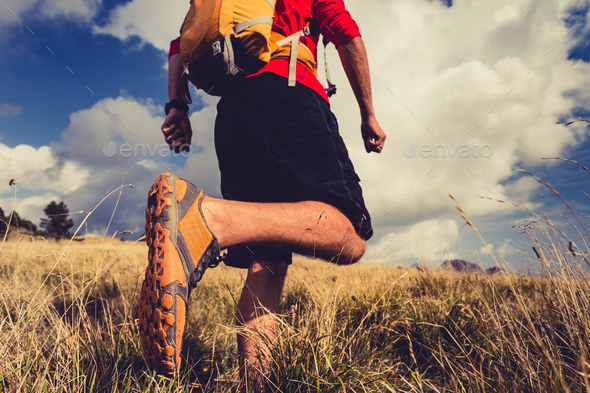 Hiker walking with backpack in beautiful landscape - Stock Photo - Images