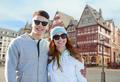 happy teenage couple over frankfurt am main city