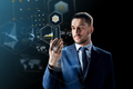 businessman with smartphone and virtual holograms