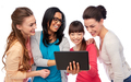 international group of happy women with tablet pc