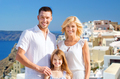 happy family over santorini island background