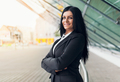 Beautiful young business woman in urban setting