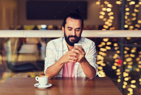 happy man with smartphone and coffee at restaurant - Stock Photo - Images