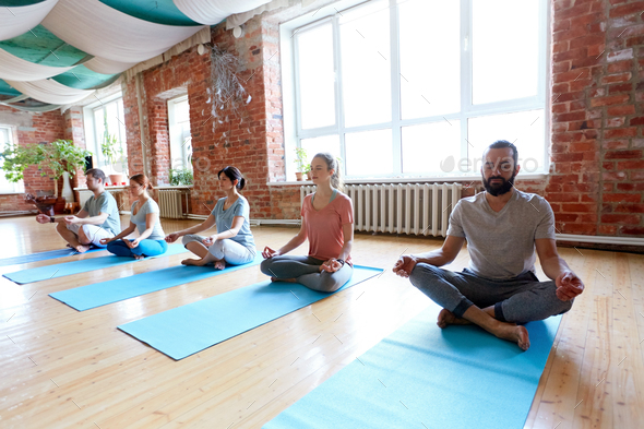 group of people meditating at yoga studio - Stock Photo - Images