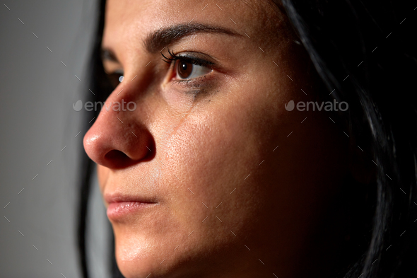 close up of unhappy crying woman - Stock Photo - Images