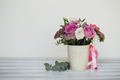 Beautiful flowers in cup on wooden background - PhotoDune Item for Sale