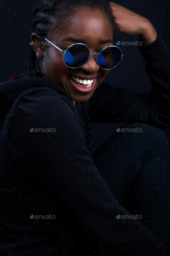 Happy Woman Wearing Sunglasses Over Black Background - Stock Photo - Images