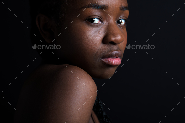 Confident Female Model Over Black Background - Stock Photo - Images