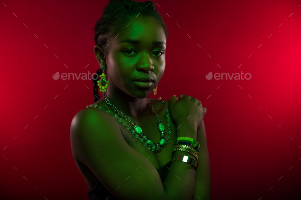 Sensuous Woman Wearing Jewelry Over Red Background - Stock Photo - Images