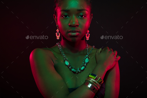 Sensuous Woman Wearing Jewelry Over Black Background - Stock Photo - Images