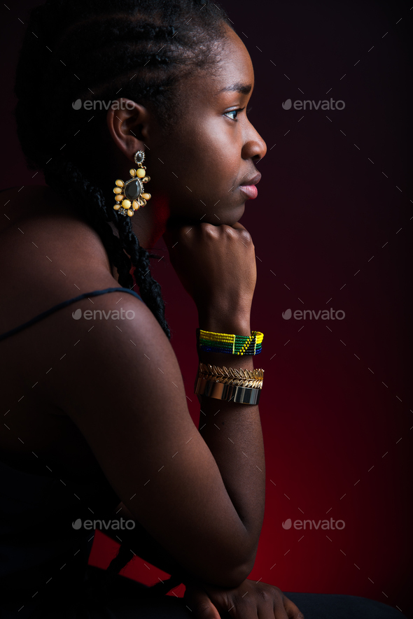 Woman Wearing Jewelry Over Red Background - Stock Photo - Images