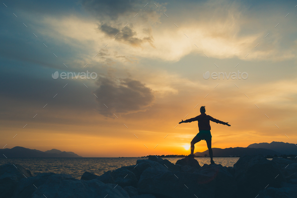 Woman hiker with arms outstretched enjoy beach and sea - Stock Photo - Images