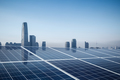 solar energy with city in morning