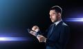businessman in suit with transparent tablet pc