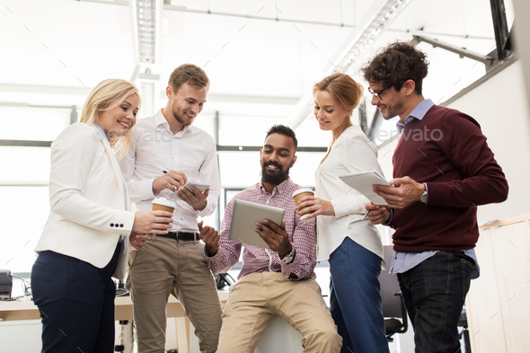 business team with tablet pc and coffee at office - Stock Photo - Images