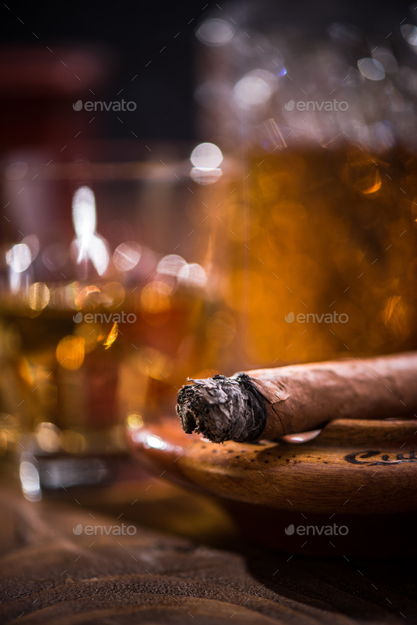 Cuban cigar smoking in wooden ashtray - Stock Photo - Images
