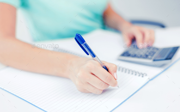 businesswoman working with calculator in office - Stock Photo - Images