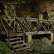 Wooden Bridge in Front of Large Rock Formation - VideoHive Item for Sale