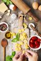 raw italian pasta tortellini on wooden board - PhotoDune Item for Sale