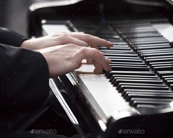 Playing piano - Stock Photo - Images