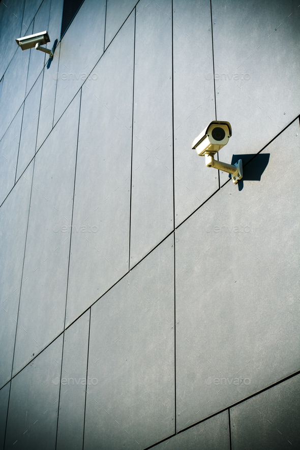 Security cameras on dark building - Stock Photo - Images