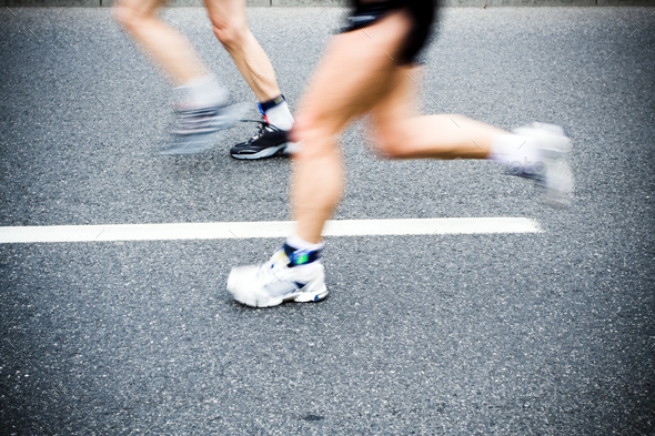 People running in marathon race on city streets - Stock Photo - Images