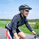 Woman riding on bicycle on summer day - PhotoDune Item for Sale