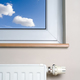 Radiator and blue sky in home interior - PhotoDune Item for Sale