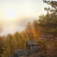 Granite cliff overlooking misty lake in northern Minnesota at sunrise - PhotoDune Item for Sale