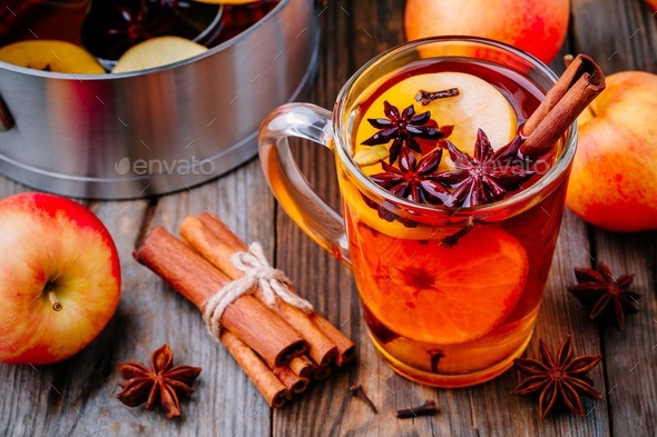 Hot mulled apple cider with cinnamon sticks, cloves and anise - Stock Photo - Images