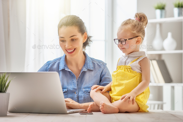 mother with toddler working - Stock Photo - Images