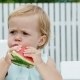 Summer, in the Garden, Funny One-year-old Blond Girl Eating Watermelon - VideoHive Item for Sale