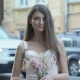 Beautiful Girl with Flowers Near Blurred Road - VideoHive Item for Sale