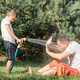 Happy father and son playing in the garden at the day time. - PhotoDune Item for Sale